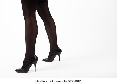 feet of a girl in stockings and shoes white background