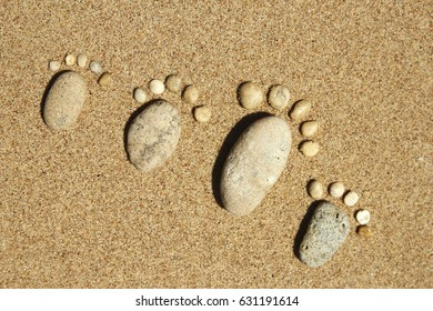 Feet of a happy family of stones on the sea