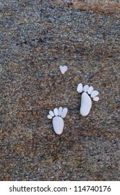 Feet and heart present with stones