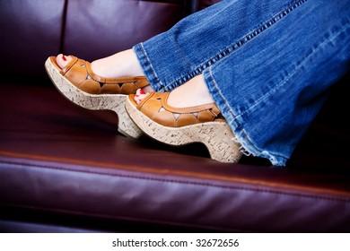feet in high heel shoes