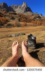 Feet of a hiker relaxing in the sun in the French Alps. Vallee de la Claree, Nevache.