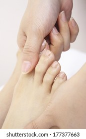Feet of Japanese woman undergoing massage