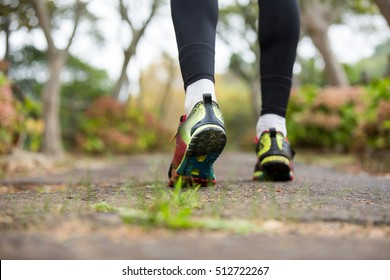 Feet of jogger jogging in park