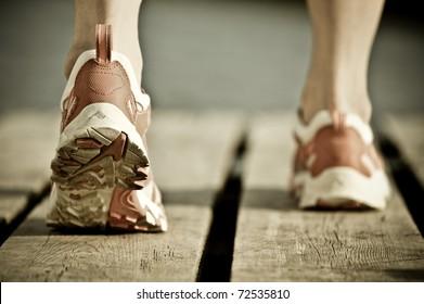 Feet of jogging man. Vintage tinted image