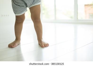 Feet of a little boy