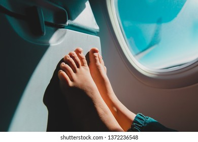 feet of little girl travel by plane, child in flight, safety
