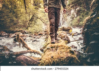 Feet Man hiking outdoor with river and forest on background Lifestyle Travel survival concept