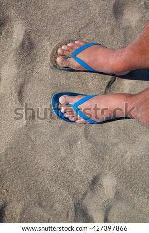 d4c8ccbd9eb26 Royalty-free stock photo ID  427397866. Feet of a man in thong sandals in beach  sand - Image