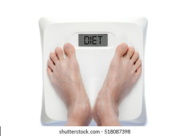 Feet on bathroom scale with the word DIET on screen. Signifies either overweight or underweight health problems requiring proper dieting.