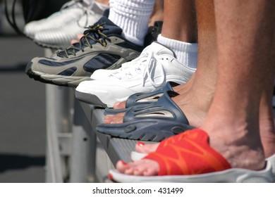feet on the bleachers