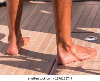 Feet on a boat deck