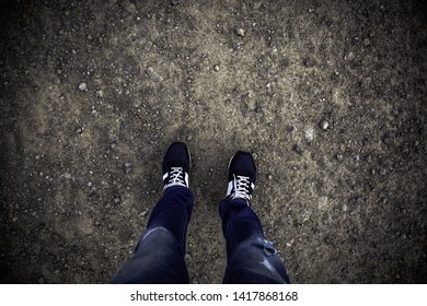 Feet on cobblestones, detail of person in the city, tourism and exploration