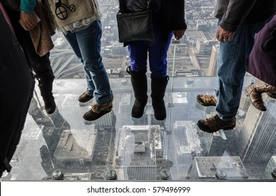 Feet on the glass balcony at the Skydeck of the Willis Tower Chicago,Illinois,USA-December 30,2012 : View from the glass balcony at the Skydeck of the Willis Tower