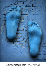 feet on old blue wall