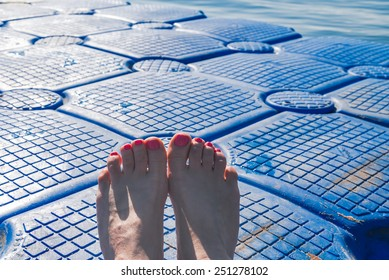 feet on the pontoon on a hot summer day, Egypt,Red sea