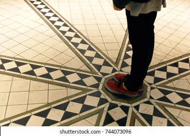 Feet on a spiral tile pattern