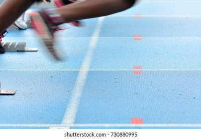 Feet on starting block ready for a spring start. Speed and motion concept.