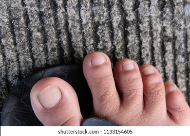 Feet on the tip of the foot, Human will have 5 inches of toe.