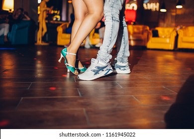 feet of people dancing in the club, a big party with incendiary music, gay dances, rehearsal of professional dance in courses for teaching rumba, ballroom dances or sports disciplines