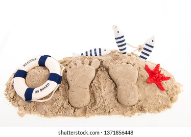 Feet prints at the beach isolated over white background