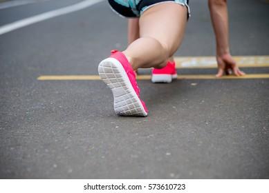 feet running on road closeup on shoe