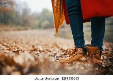 feet scarf autumn park yellow leaves