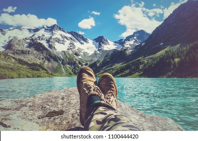 Feet Selfie Traveler relaxing with lake and mountains view on background Lifestyle hiking Travel concept summer vacations adventure outdoor