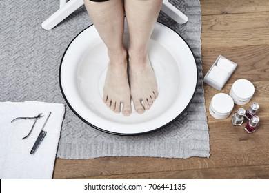 Feet soak before pedicure in water