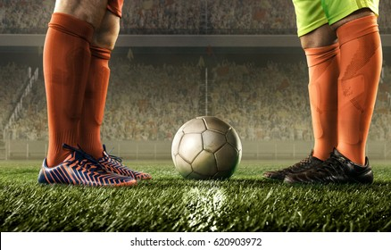 feet of soccer players before starting a match