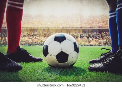 feet of soccer players kick off in the stadium match