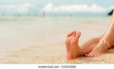 feet, sole of feet against the sea Pedicure and foot Spa.Care for the heels and soles of the feet. Foot massage.