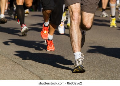 feet of some runners in a marathon competition