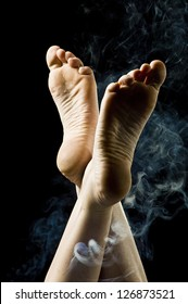 Feet surrounded by smoke