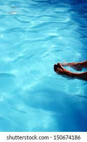 Feet in swimmingpool