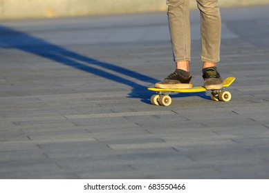 feet teen skateboarding in the city