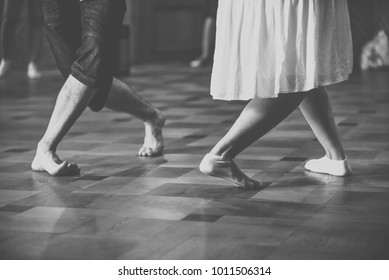 Feet of two dancers. Black and white vintage style photo.