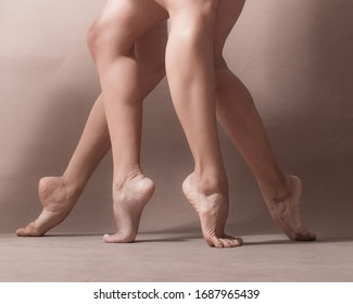 Feet of two Latin Ballerinas on toes