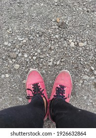 feet wear red shoes on a rocky background