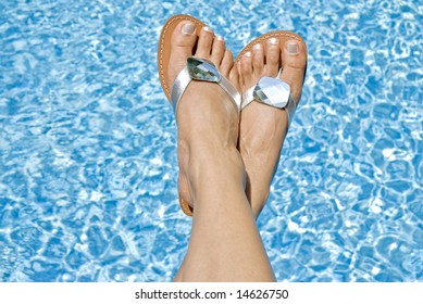 Feet Wearing Flipflop over the Swimming Pool
