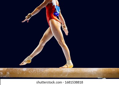 feet woman gymnast athlete in balance beam exercise