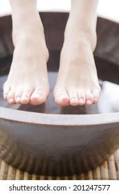 The feet of woman undergoing foot bath