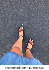 feet of a woman wearing sandals