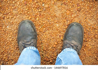 feet in work boots on gravel