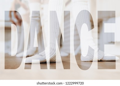 Feet of Young Ballerinas in White Dance Shoes. Legs in Second Position on a Floor. Adorable Little Girls Practicing Ballet at Class. Ballet Barre Exercises. Kids in Ballet Wear in Bright Dance Room.