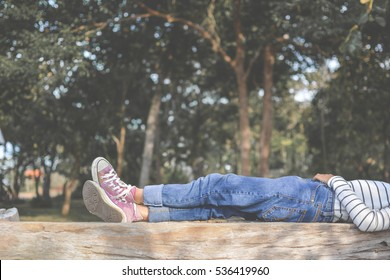 Feet of young girl sleep in the park on nature, Relax time on holiday concept travel , color of hipster tone