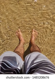 Feet's cooling in sea shallow water.