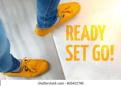 Feets in yellow shoes on stairs with inscription Ready set go!