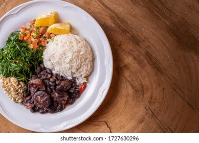 Feijoada, typical Brazilian food with black beans, pork and sausage