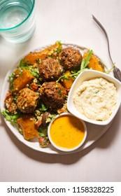Felafels with bulgur, rocket leaves, butternut squash salad & houmous & tahini lemon dressing