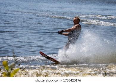 FELBRIDGE, SURREY/UK - AUGUST 2 : Water skiing at Wiremill Lake near Felbridge Surrey on August 2, 2020. One unidentifed man